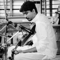Indian classical violinist, can give you tuition for playing indian style violin.