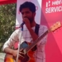 Play guitar in 4 month. With singing in 6 month if practicing daily.